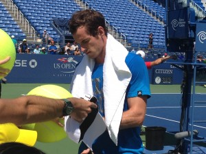 Andy Murray signing those infamous giant tennis balls.