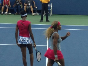 "Serena and Venus Williams playing doubles. I sat in her family's ""box""."